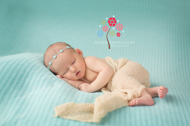 Newborn photographer hoboken new jersey taking pictures of the beauty with green backdrop
