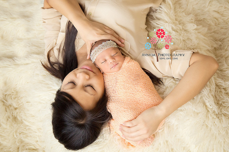 Zoe lying by side of her mommy in picture from newborn photography ocean county nj by