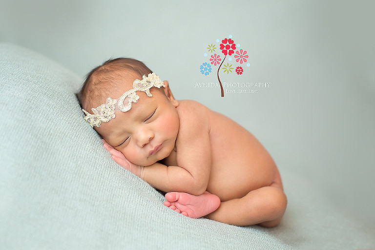 Zoe in green blanket in picture from newborn photography ocean county nj by www avnidaphotography