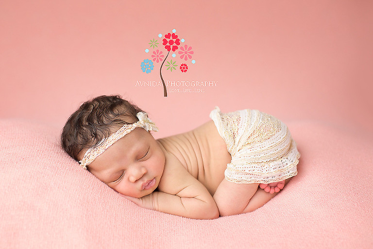 Picture of a cute newborn in the cutest skirt from your newborn photographer middletown nj