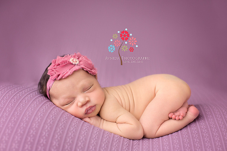 Picture of a cute newborn in the taco pose from your newborn photographer middletown nj by