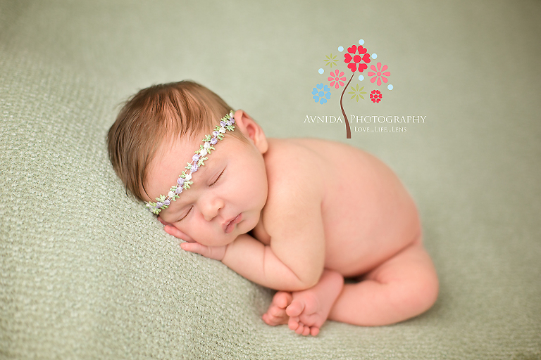newborn photography morristown nj the princess sleeping on a green blanket by www.avnidaphotography.com