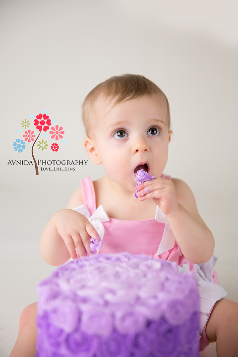 cake smash photography bridgewater nj coco cake in mouth by www.avnidaphotography.com