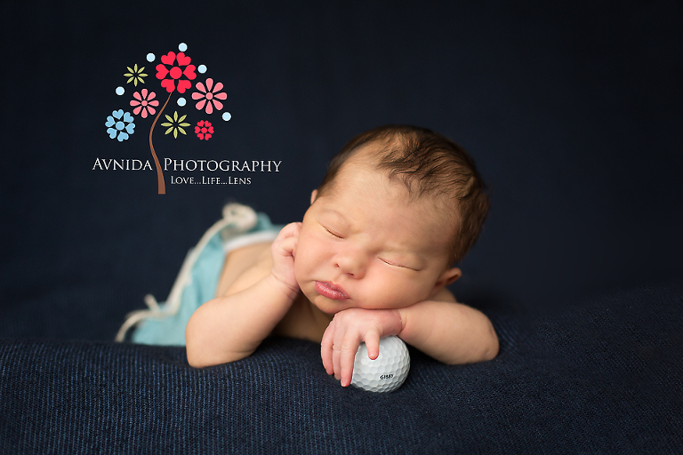 Newborn photography millburn nj posing with a golf ball