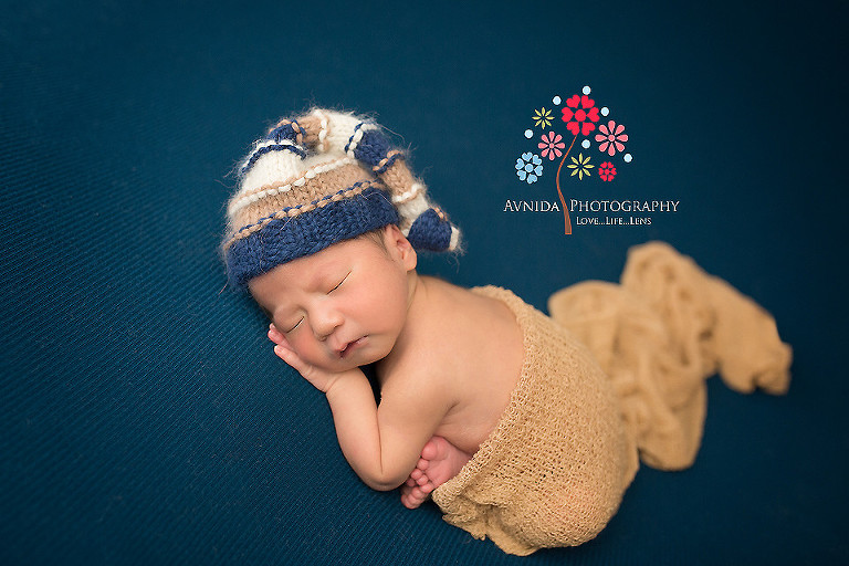 Newborn photography west orange nj in the blue and brown cap