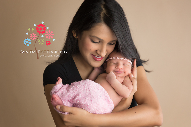 Newborn photography central nj mom is head over heels in love with her little baby