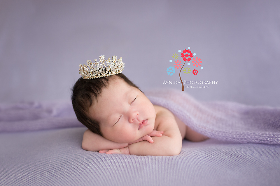With the hand on the chin and the cute pink hat, Emma looks lovely in this photo from her 4 week old newborn photography session