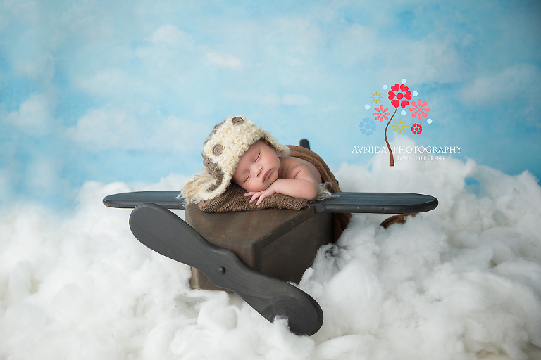Nigel taking his plane into the clouds for his newborn baby photography session