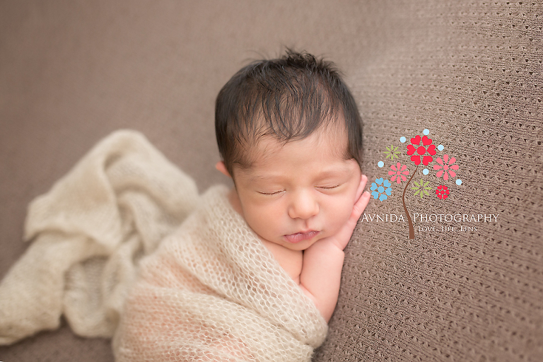 West orange nj newborn photographer baby martin in a cute brown wrap looking so