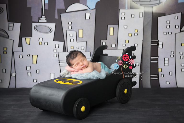 West Orange NJ newborn photographer - Batman is sleeping on the job. That's not good