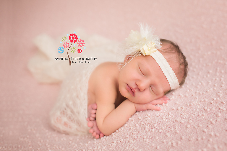 West orange nj newborn photographer an angel wrapped in a white blanket with a white