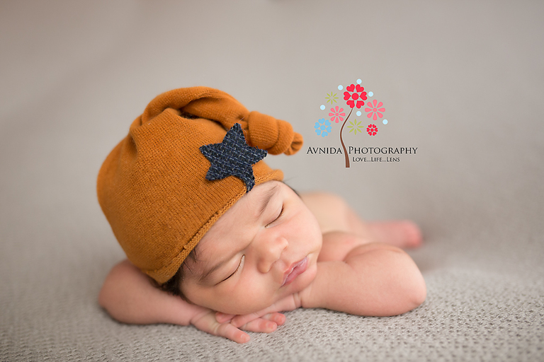 Verona nj newborn photographer baby marcos repeats the perfect hands on chin performance in a