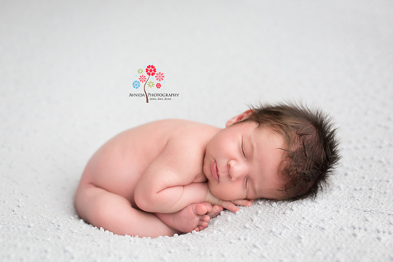Newborn photographer somerset nj doing a yoga pose effortlessly