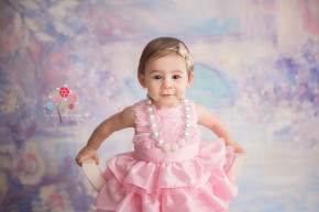 Cake Smash Photography Far Hills NJ - The princess learns early on how to sit on a throne.