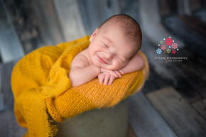 Newborn Photography Englewood Cliffs NJ - A happy smile, a striking color and we have victory ladies and gentlemen - this is one of my favorite photos