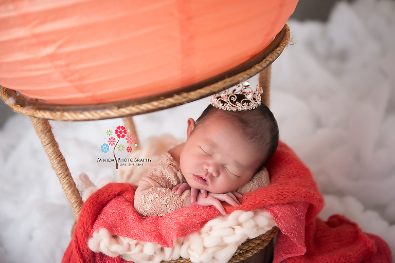 Newborn Photography Lawrenceville NJ - A little close-up of the little princess with overflowing red blanket representing a nice breeze blowing by