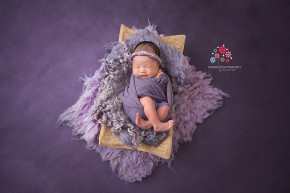 Newborn Photography Lawrenceville NJ - Now, I cannot pick a favorite from the various photos of Baby Cayla but this one surely sits at the top of the list - The combination of colors just came out so perfect combined with that little hint of smile