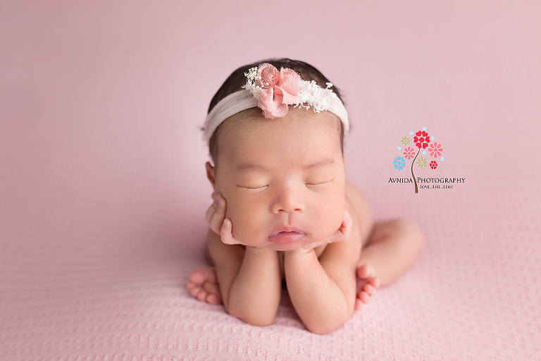 Newborn photography flemington nj hands on chin pose executed beautifully by baby rachel