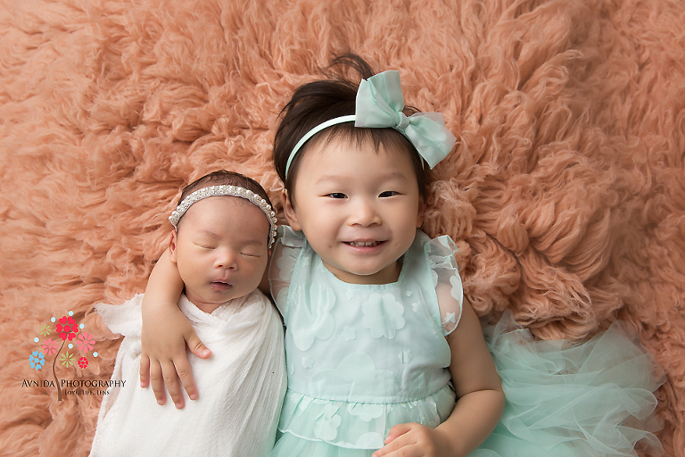 Newborn photography flemington nj sisters typically make the best friends and it seems it won