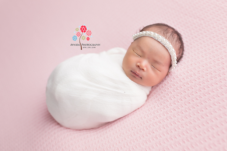 Newborn photography flemington nj the familys bundle of joy photographed in light pastel colors that