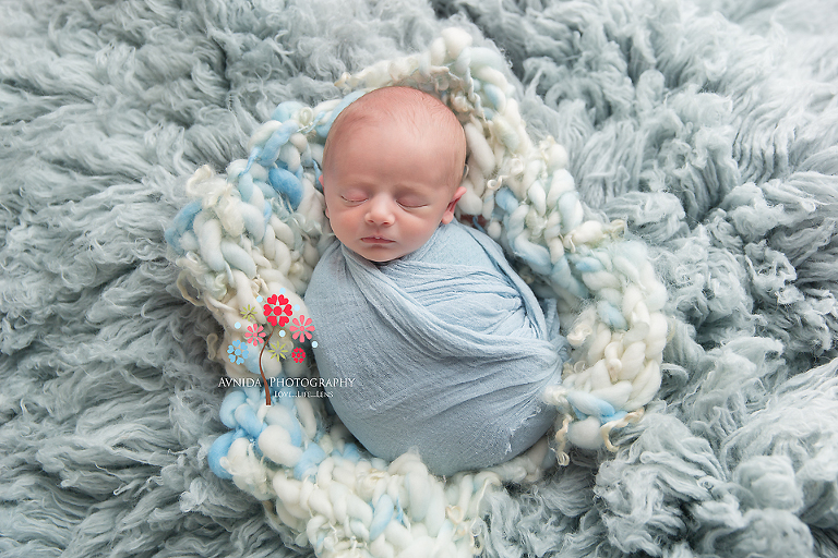 Basking Ridge Newborn Photography NJ - Baby Jackson is one cute bundle of joy floating on a sea of warm blue blankets, what could be more cute