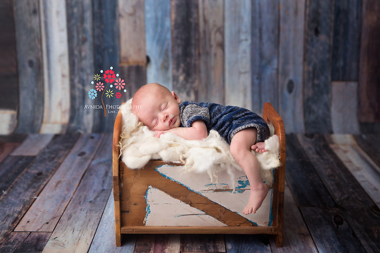 Basking ridge newborn photography nj leg hanging over the side baby jackson is sleeping