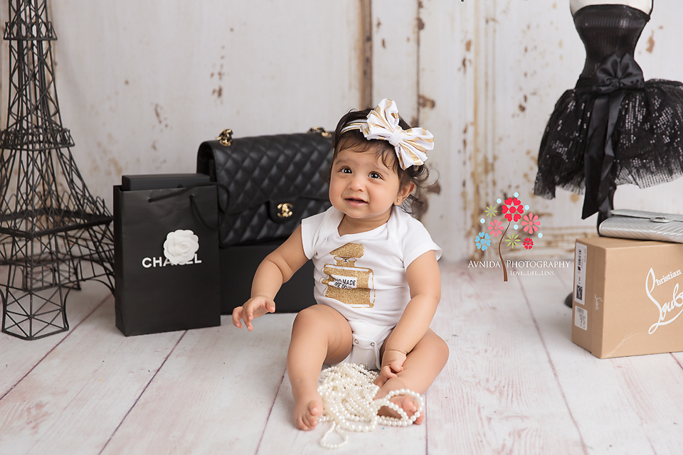 Cake Smash Photography Saddle River NJ - Baby Ahayli has just landed in beautiful Paris, and seems a little overwhelmed with the shopping choices - so many things to do and buy