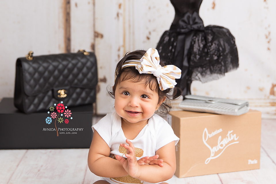 Cake Smash Photography Saddle River NJ - Slowly but surely, we see a transformation - Baby Ahayli is now all excited, smiling and happy about her new Christian Louboutin shoes