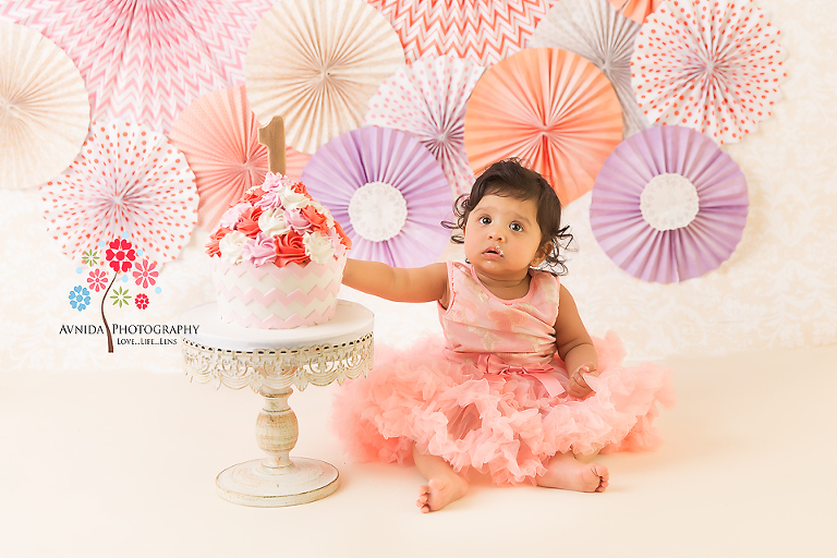 Cake Smash Photography Saddle River NJ - The beauty of the paper pinwheel theme in full display, the colors chosen carefully by our resident designer