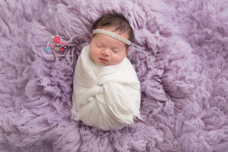 Newborn Photography Spring Lake NJ - A little bundle of joy, wrapped in white against an equally beautiful lavender blanket