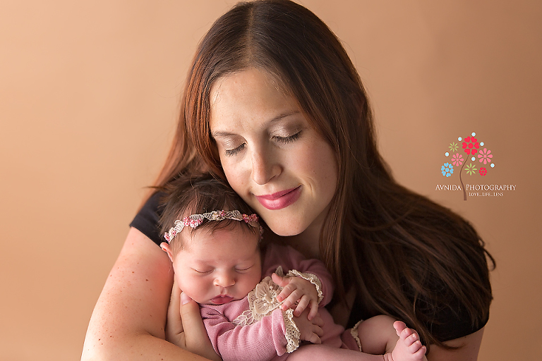 Newborn Photography Spring Lake NJ - Like mom, like daughter, two peas in a pod, just hugging each other in affectionate love