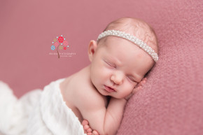 Newborn Photography Rumson NJ - A close up of the photograph in white - can you tell that Skylar was a good sleeper during newborn session