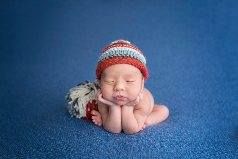 Newborn Photography Oldwick NJ - Another pose executed perfectly by Omer - doesn't this shade of blue brighten up the photo