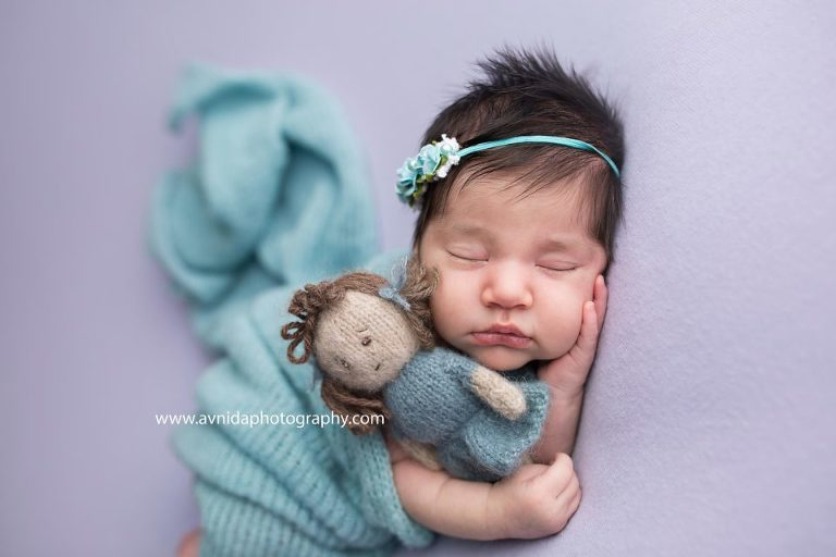 Newborn photography monmouth county nj a princess needs her side kick along her at all