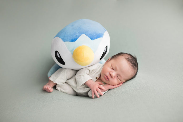 Newborn photography westfield nj session by avnida photography the penguin looks over friend wondering when